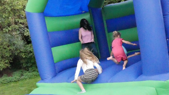 Children adopted through Diagrama playing on bouncy castle with social worker